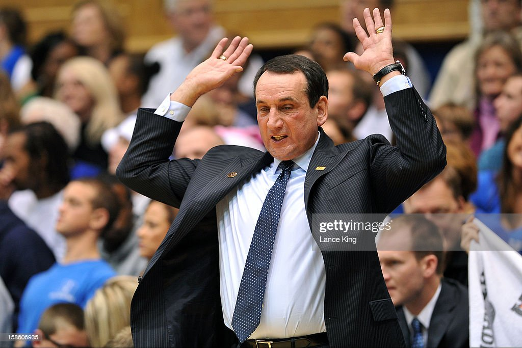 Head Coach <a gi-track='captionPersonalityLinkClicked' href=/galleries/search?phrase=Mike+Krzyzewski&family=editorial&specificpeople=213322 ng-click='$event.stopPropagation()'>Mike Krzyzewski</a> of the Duke Blue Devils reacts from the sideline against the Elon Phoenix at Cameron Indoor Stadium on December 20, 2012 in Durham, North Carolina. Duke defeated Elon 76-54.