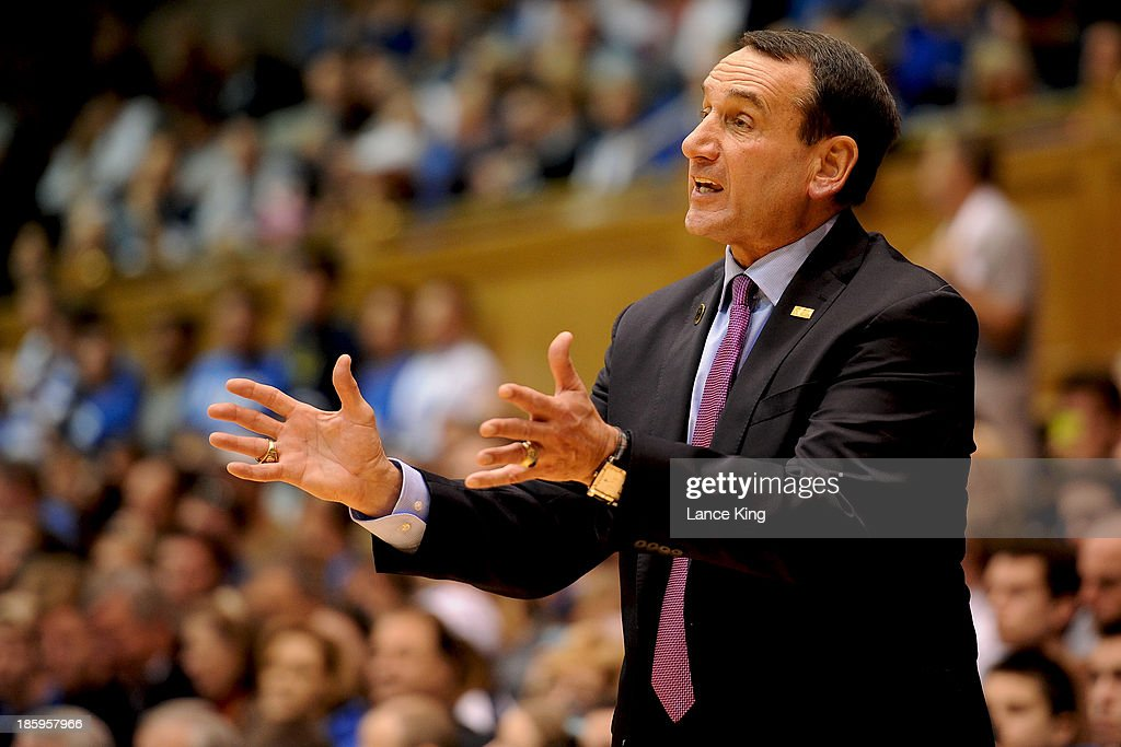 Head Coach <a gi-track='captionPersonalityLinkClicked' href=/galleries/search?phrase=Mike+Krzyzewski&family=editorial&specificpeople=213322 ng-click='$event.stopPropagation()'>Mike Krzyzewski</a> of the Duke Blue Devils reacts to a play against the Bowie State Bulldogs at Cameron Indoor Stadium on October 26, 2013 in Durham, North Carolina. Duke defeated Bowie State 103-67.