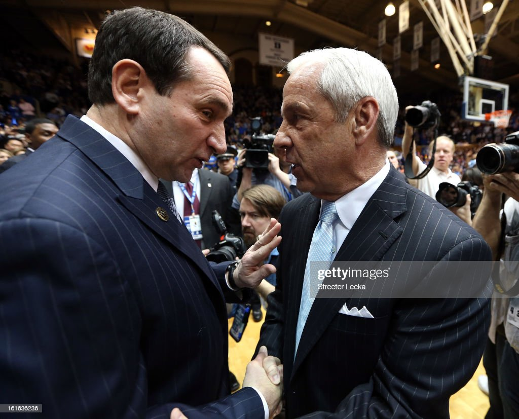 Head coach <a gi-track='captionPersonalityLinkClicked' href=/galleries/search?phrase=Mike+Krzyzewski&family=editorial&specificpeople=213322 ng-click='$event.stopPropagation()'>Mike Krzyzewski</a> of the Duke Blue Devils shakes hands with head coach Roy Williams of the North Carolina Tar Heels before their game at Cameron Indoor Stadium on February 13, 2013 in Durham, North Carolina.