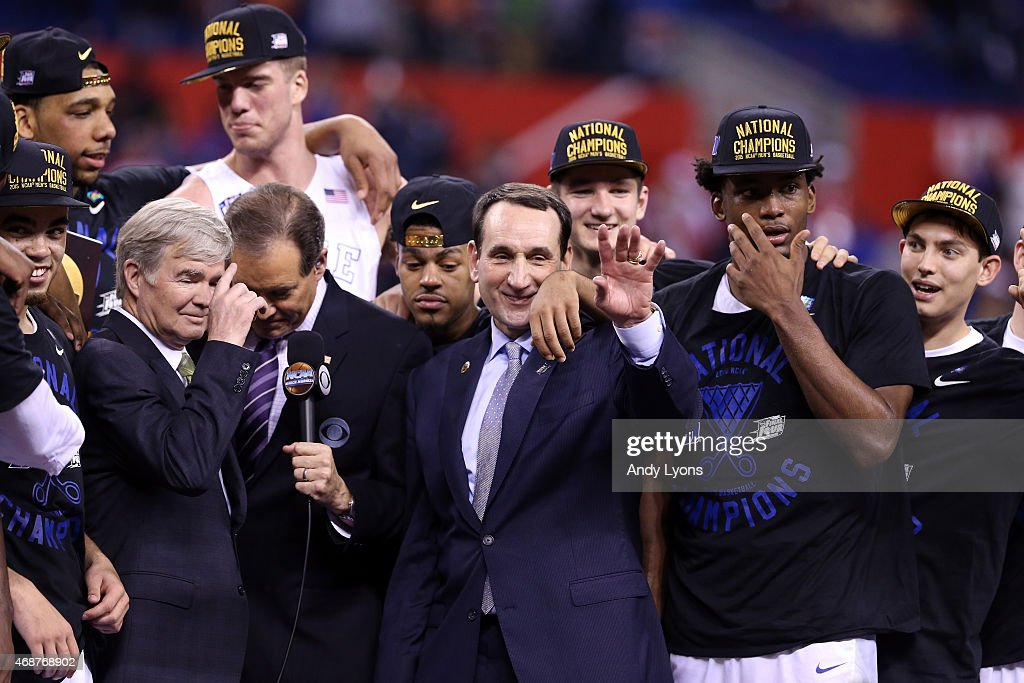 Head coach <a gi-track='captionPersonalityLinkClicked' href=/galleries/search?phrase=Mike+Krzyzewski&family=editorial&specificpeople=213322 ng-click='$event.stopPropagation()'>Mike Krzyzewski</a> of the Duke Blue Devils speaks to NCAA President Dr. <a gi-track='captionPersonalityLinkClicked' href=/galleries/search?phrase=Mark+Emmert&family=editorial&specificpeople=2643280 ng-click='$event.stopPropagation()'>Mark Emmert</a> and CBS correspondent <a gi-track='captionPersonalityLinkClicked' href=/galleries/search?phrase=Jim+Nantz&family=editorial&specificpeople=700519 ng-click='$event.stopPropagation()'>Jim Nantz</a> after defeating the Wisconsin Badgers during the NCAA Men's Final Four National Championship at Lucas Oil Stadium on April 6, 2015 in Indianapolis, Indiana. Duke defeated Wisconsin 68-63.