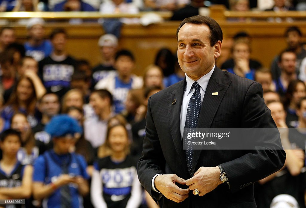 Head coach <a gi-track='captionPersonalityLinkClicked' href=/galleries/search?phrase=Mike+Krzyzewski&family=editorial&specificpeople=213322 ng-click='$event.stopPropagation()'>Mike Krzyzewski</a> of the Duke Blue Devils speaks to the crowd as he is acknowledged for breaking the record for wins in NCAA men's basketball at Cameron Indoor Stadium on November 18, 2011 in Durham, North Carolina.