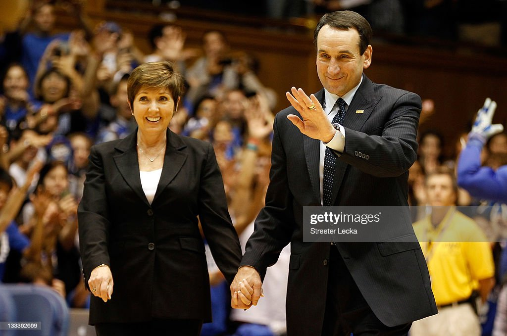 Head coach <a gi-track='captionPersonalityLinkClicked' href=/galleries/search?phrase=Mike+Krzyzewski&family=editorial&specificpeople=213322 ng-click='$event.stopPropagation()'>Mike Krzyzewski</a> of the Duke Blue Devils stands with his wife Micki as he is acknowledged for breaking the record for wins in NCAA men's basketball at Cameron Indoor Stadium on November 18, 2011 in Durham, North Carolina.