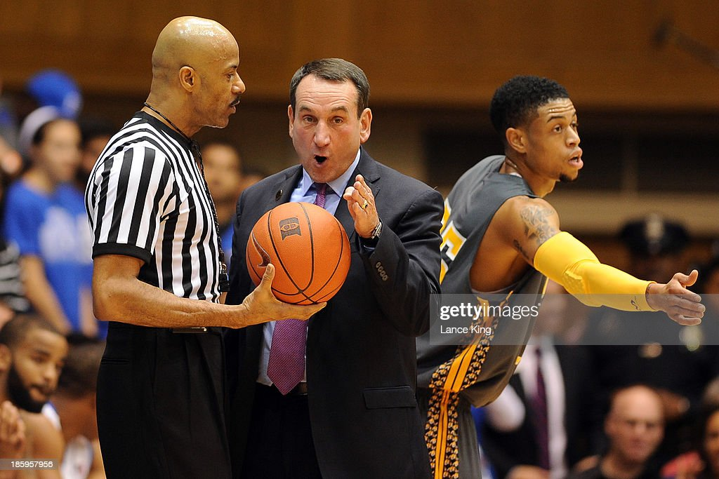 Head Coach <a gi-track='captionPersonalityLinkClicked' href=/galleries/search?phrase=Mike+Krzyzewski&family=editorial&specificpeople=213322 ng-click='$event.stopPropagation()'>Mike Krzyzewski</a> of the Duke Blue Devils talks with referee Dwayne Gladden during a game against the Bowie State Bulldogs at Cameron Indoor Stadium on October 26, 2013 in Durham, North Carolina.