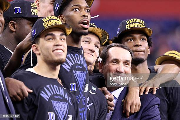 Head coach Mike Krzyzewski of the Duke Blue Devils watches 'One Shining Moment' with his playersTyus Jones Amile Jefferson Grayson Allen and Justise...