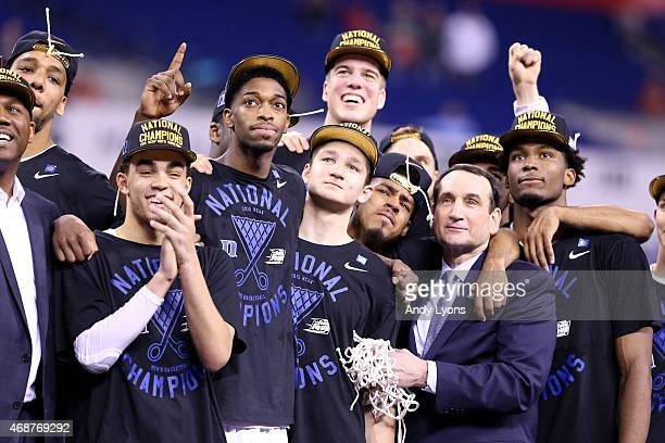 Head coach Mike Krzyzewski of the Duke Blue Devils watches 'One Shining Moment' with his players Jahlil Okafor Tyus Jones Amile Jefferson Grayson...