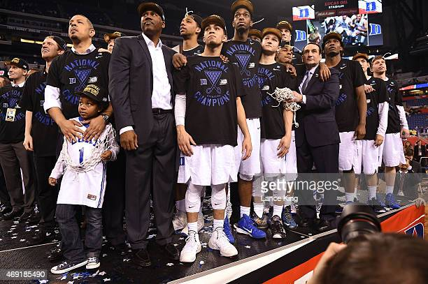 Head Coach Mike Krzyzewski of the Duke Blue Devils watches 'One Shining Moment' with his team after defeating the Wisconsin Badgers during the NCAA...