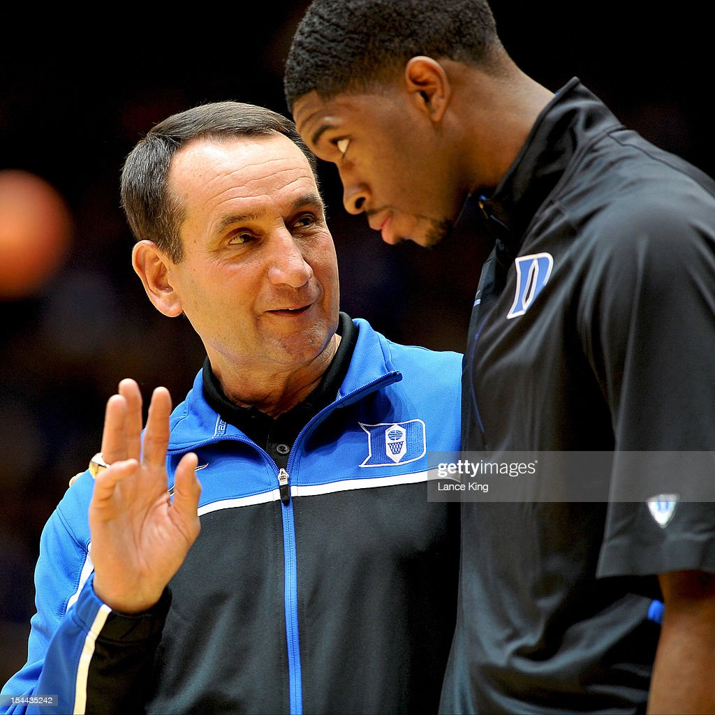 Head Coach <a gi-track='captionPersonalityLinkClicked' href=/galleries/search?phrase=Mike+Krzyzewski&family=editorial&specificpeople=213322 ng-click='$event.stopPropagation()'>Mike Krzyzewski</a> talks to Amile Jefferson #2 of the Duke Blue Devils during Countdown to Craziness at Cameron Indoor Stadium on October 19, 2012 in Durham, North Carolina.