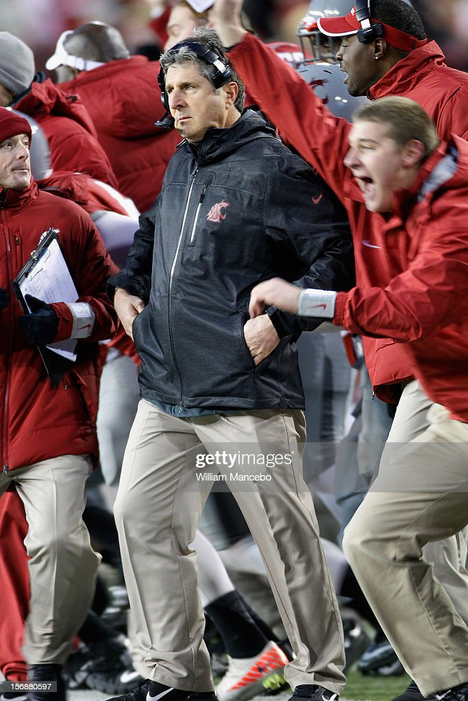 Head coach Mike Leach of the Washington State Cougars reacts as the Cougars win the Apple Cup 31-28 during overtime against the Washington Huskies at Martin Stadium on November 23, 2012 in Pullman, Washington.