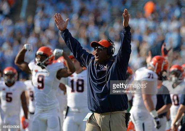 Head coach Mike London of the Virginia Cavaliers reacts after a touchdown against the North Carolina Tar Heels during their game at Kenan Stadium on...