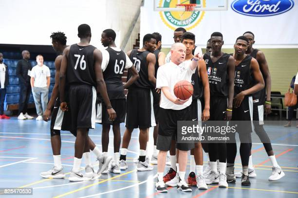 Head Coach Mike Malone of the Denver Nuggets runs drills during the Basketball Without Borders Africa at the American International School of...