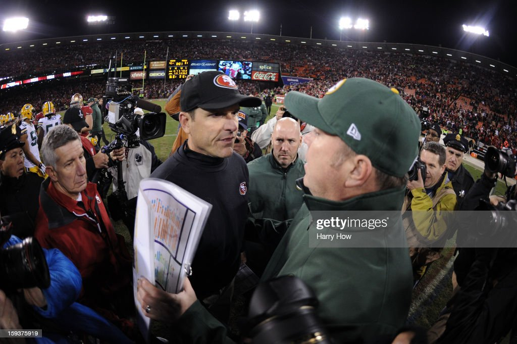 Head coach Mike McCarthy (R) of the Green Bay Packers congratulates head coach <a gi-track='captionPersonalityLinkClicked' href=/galleries/search?phrase=Jim+Harbaugh&family=editorial&specificpeople=779595 ng-click='$event.stopPropagation()'>Jim Harbaugh</a> (L) of the San Francisco 49ers after their NFC Divisional Playoff Game at Candlestick Park on January 12, 2013 in San Francisco, California. The San Francisco 49ers defeated the Green Bay Packers 45 to 31.