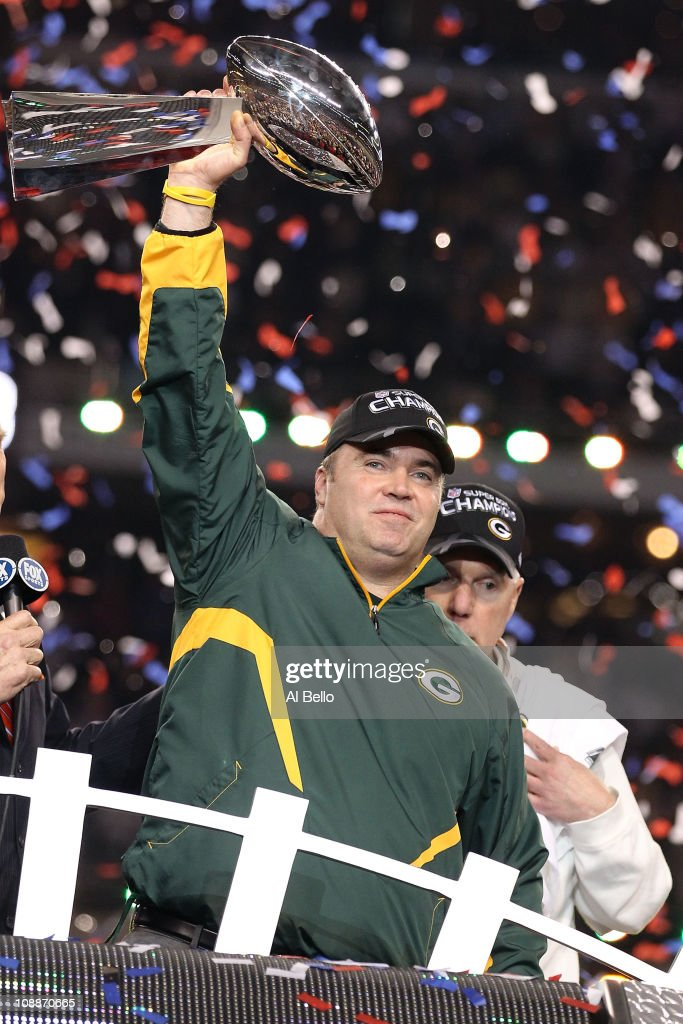 Head coach <a gi-track='captionPersonalityLinkClicked' href=/galleries/search?phrase=Mike+McCarthy+-+American+Football+Coach&family=editorial&specificpeople=639233 ng-click='$event.stopPropagation()'>Mike McCarthy</a> of the Green Bay Packers holds up the Vince Lombardi Trophy after winning Super Bowl XLV 31-25 against the Pittsburgh Steelers at Cowboys Stadium on February 6, 2011 in Arlington, Texas.