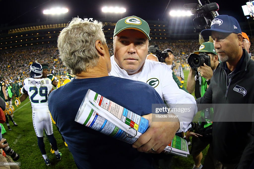 Head coach Mike McCarthy (R) of the Green Bay Packers hugs head coach Pete Carroll (L) of the Seattle Seahawks after their game at Lambeau Field on September 20, 2015 in Green Bay, Wisconsin. The Green Bay Packers defeated the Seattle Seahawks 27 to 17.