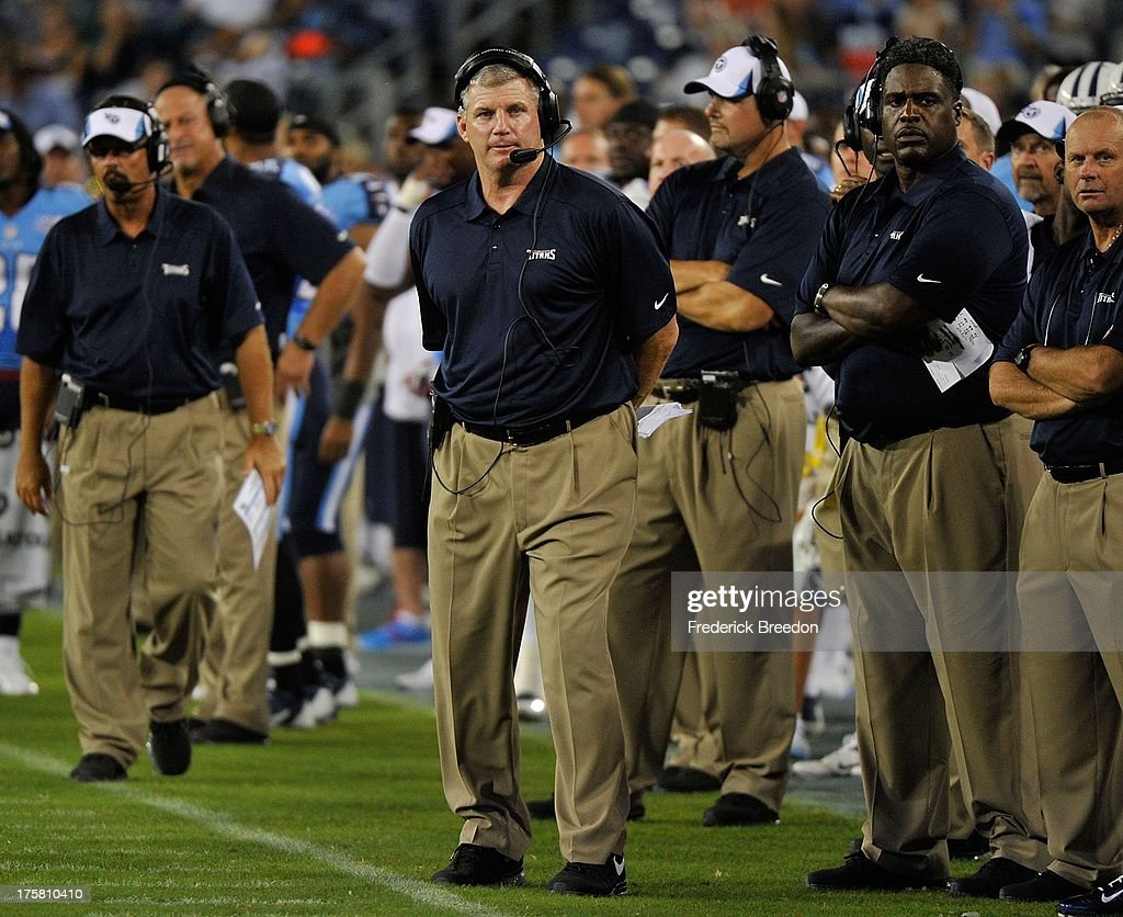 Head coach <a gi-track='captionPersonalityLinkClicked' href=/galleries/search?phrase=Mike+Munchak&family=editorial&specificpeople=758157 ng-click='$event.stopPropagation()'>Mike Munchak</a> of the Tennessee Titans watches his team play against the Washington Redskins during a pre-season game at LP Field on August 8, 2013 in Nashville, Tennessee.