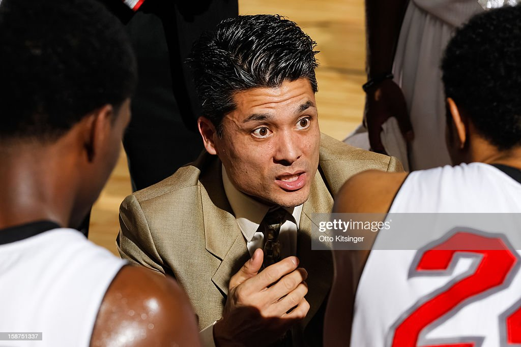 Head Coach Mike Peck of the Idaho Stampede talks to his team during a time out in the NBA D-League game against the Maine Red Claws on December 26, 2012 at CenturyLink Arena in Boise, Idaho.