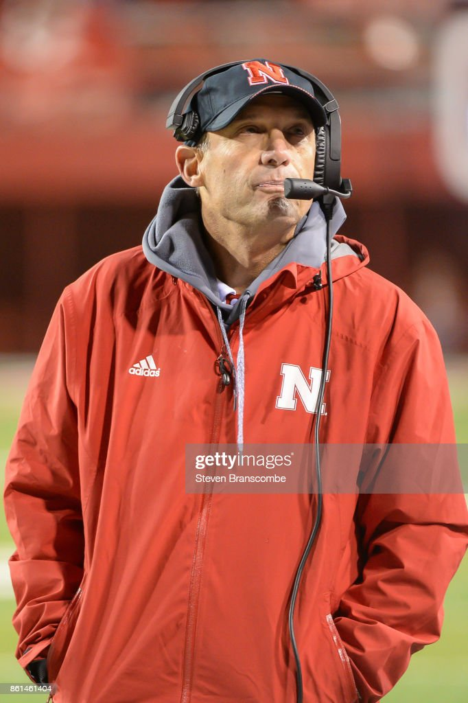 Head coach Mike Riley of the Nebraska Cornhuskers looks at the clock in late game action against the Ohio State Buckeyes at Memorial Stadium on October 14, 2017 in Lincoln, Nebraska.