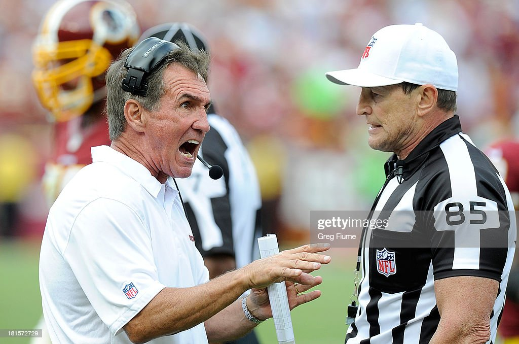 Head coach <a gi-track='captionPersonalityLinkClicked' href=/galleries/search?phrase=Mike+Shanahan&family=editorial&specificpeople=213113 ng-click='$event.stopPropagation()'>Mike Shanahan</a> of the Washington Redskins argues a call with referee <a gi-track='captionPersonalityLinkClicked' href=/galleries/search?phrase=Ed+Hochuli&family=editorial&specificpeople=2091125 ng-click='$event.stopPropagation()'>Ed Hochuli</a> #85 in the fourth quarter against the Detroit Lions at FedExField on September 22, 2013 in Landover, Maryland.