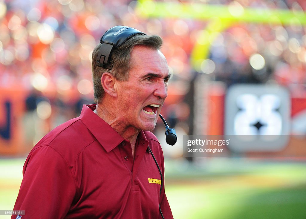 Head Coach Mike Shanahan of the Washington Redskins disputes a call by an official during the game against the Denver Broncos at Sports Authority Field on October 27, 2013 in Denver, Colorado.
