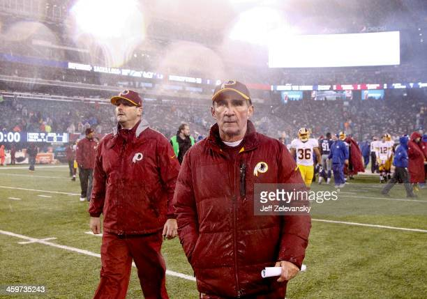 Head coach Mike Shanahan of the Washington Redskins walks off the field after a loss to the New York Giants at MetLife Stadium on December 29 2013 in...