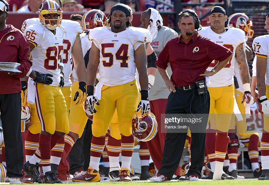 Head coach <a gi-track='captionPersonalityLinkClicked' href=/galleries/search?phrase=Mike+Shanahan&family=editorial&specificpeople=213113 ng-click='$event.stopPropagation()'>Mike Shanahan</a> of the Washington Redskins watches play against the Buffalo Bills in the first half during a preseason game at FedExField on August 24, 2013 in Landover, Maryland. The Washington Redskins won, 30-7.