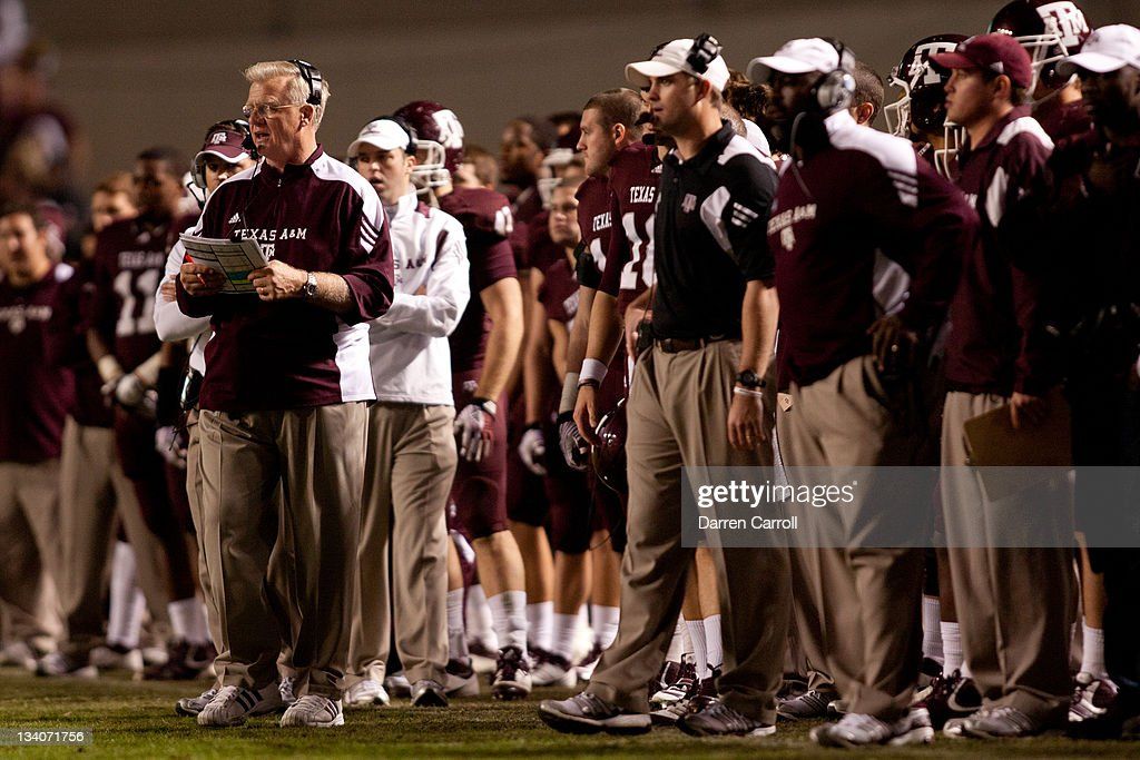 Head Coach <a gi-track='captionPersonalityLinkClicked' href=/galleries/search?phrase=Mike+Sherman&family=editorial&specificpeople=211132 ng-click='$event.stopPropagation()'>Mike Sherman</a> the Texas A&M Aggies works the sidelines in a game against the Texas Longhorns at Kyle Field on November 24, 2011 in College Station, Texas.