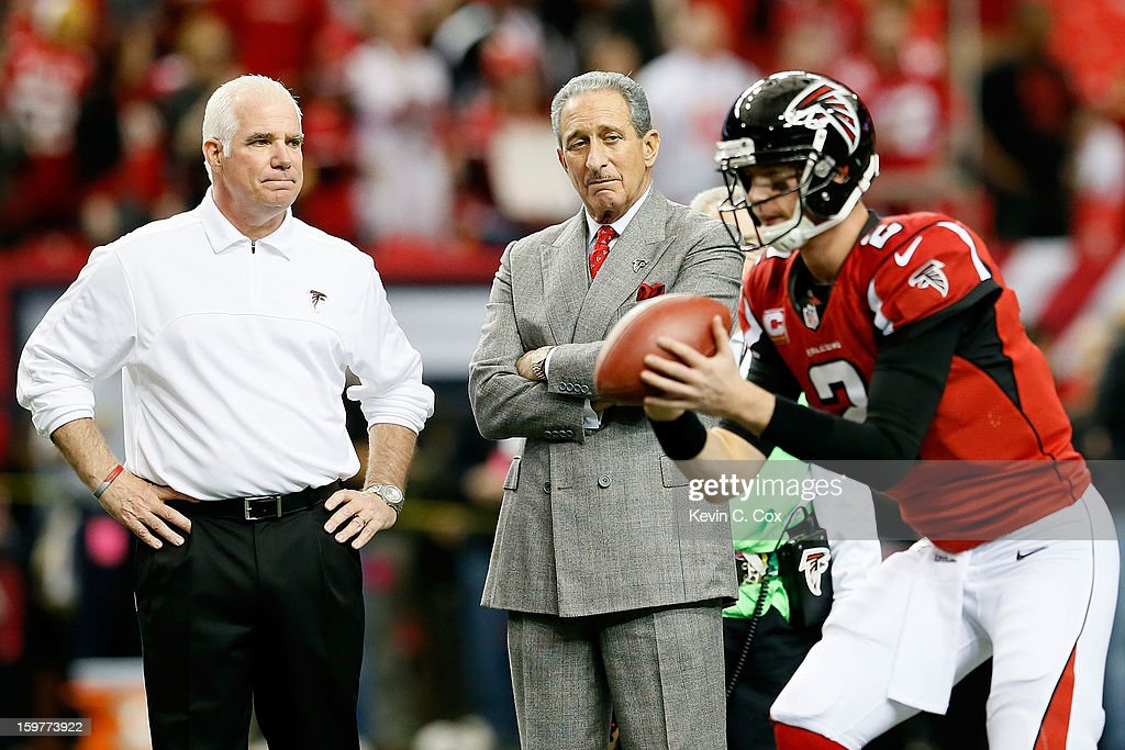 Head coach Mike Smith and owner Arthur Blank of the Atlanta Falcons watch quarterback Matt Ryan #2 of the Falcons warm up before taking on the San Francisco 49ers in the NFC Championship game at the Georgia Dome on January 20, 2013 in Atlanta, Georgia.
