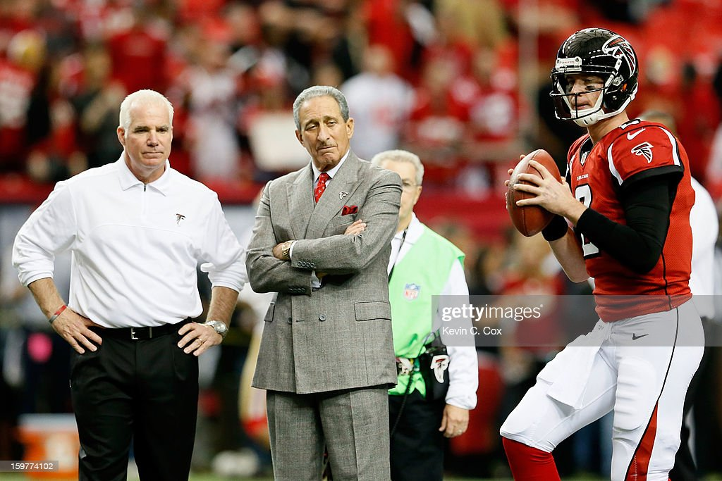 Head coach Mike Smith and owner Arthur Blank of the Atlanta Falcons watch quarterback Matt Ryan of the Falcons warm up before taking on the San...