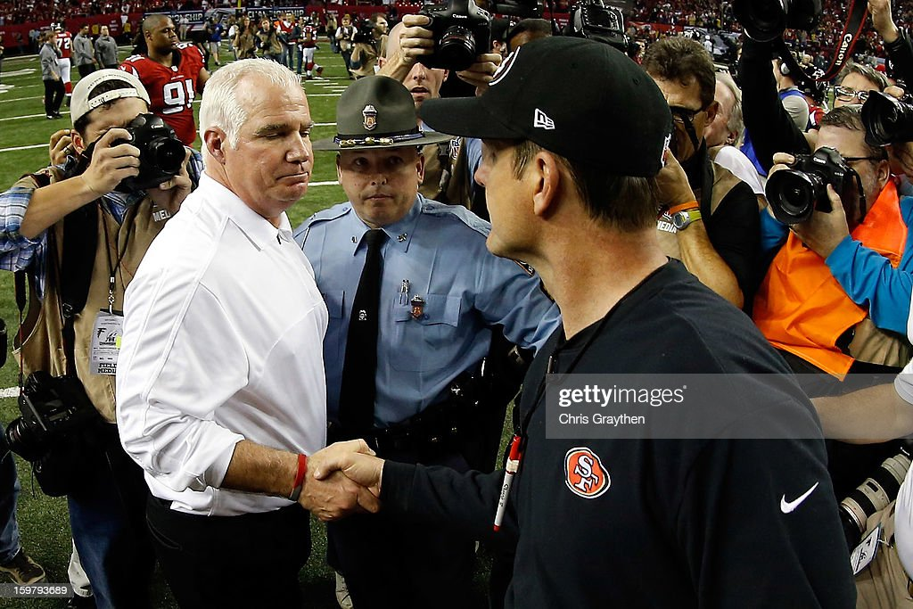 Head coach Mike Smith of the Atlanta Falcons and head coach Jim Harbaugh of the San Francisco 49ers shake hands after the 49ers defeat the Falcons 28-24 in the NFC Championship game at the Georgia Dome on January 20, 2013 in Atlanta, Georgia.
