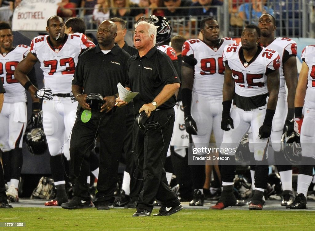 Head coach Mike Smith of the Atlanta Falcons coaches his team against the Tennessee Titans at LP Field on August 24, 2013 in Nashville, Tennessee.