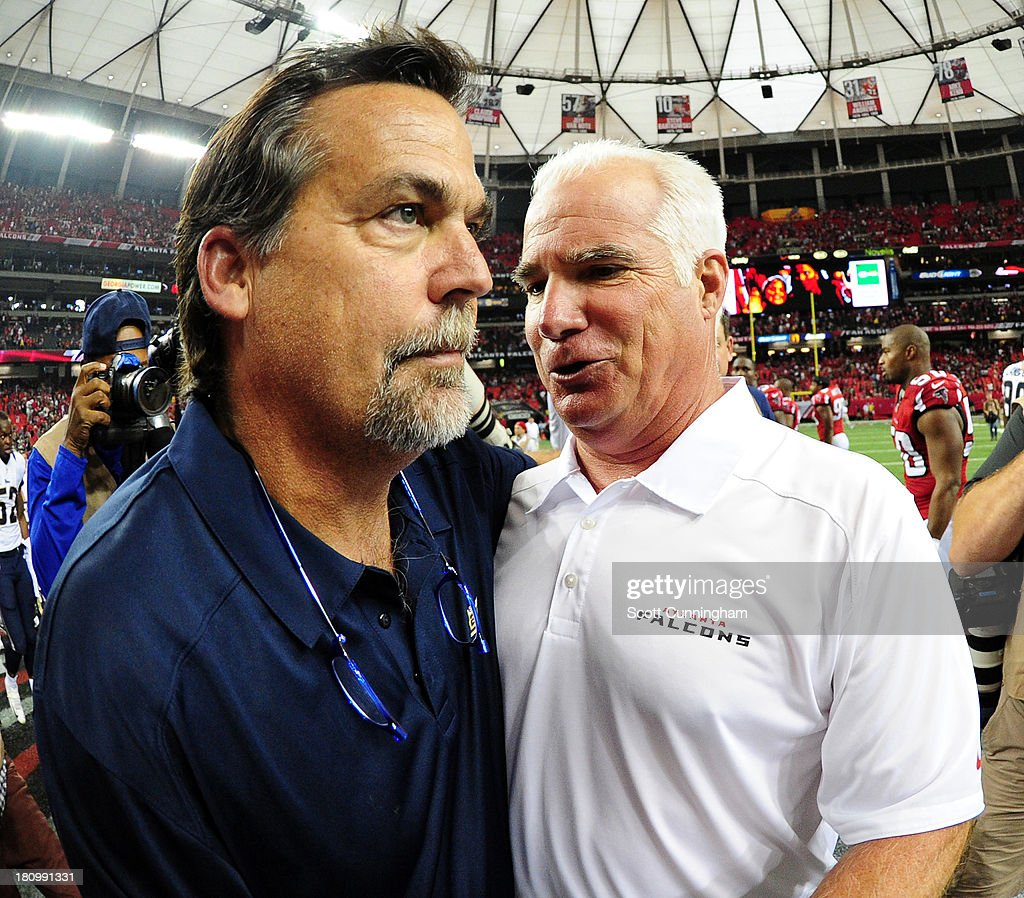 Head coach Mike Smith (R) of the Atlanta Falcons is congratulated by head coach Jeff Fisher of the St. Louis Rams after the game at the Georgia Dome on September 15, 2013 in Atlanta, Georgia.