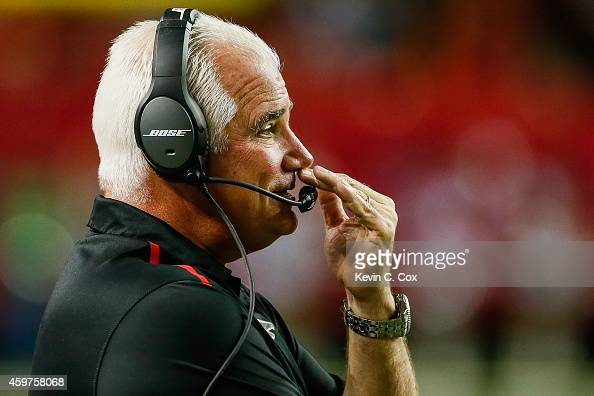 Head coach Mike Smith of the Atlanta Falcons reacts to a play during the first half against the Arizona Cardinals at the Georgia Dome on November 30...