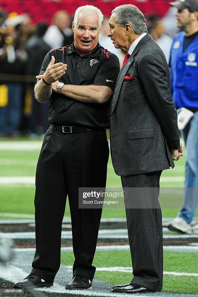 Head coach Mike Smith of the Atlanta Falcons talks to Arthur Blank the team owner prior to the game against the Pittsburgh Steelers at the Georgia...