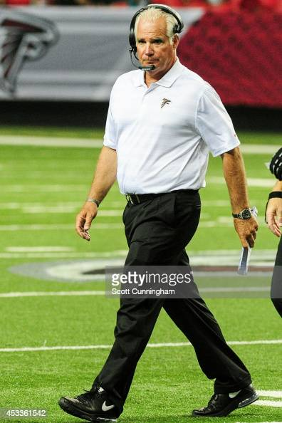Head coach Mike Smith of the Atlanta Falcons walks on the field in the fourth quarter of a preseason game against the Miami Dolphins at the Georgia...