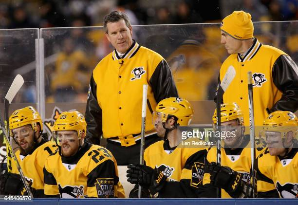 Head Coach Mike Sullivan left and assistant coach Rick Tocchet of the Pittsburgh Penguins look on from the bench area during the second period of the...