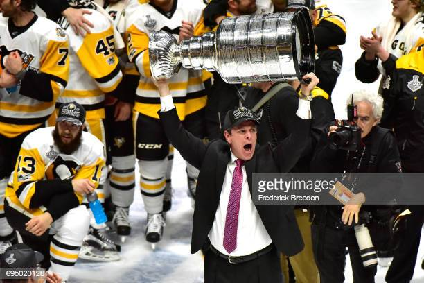Head coach Mike Sullivan of the Pittsburgh Penguins celebrates with the Stanley Cup Trophy after defeating the Nashville Predators 20 in Game Six of...