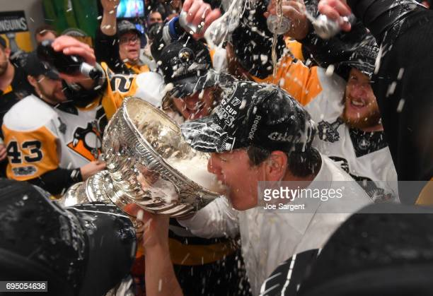 Head Coach Mike Sullivan of the Pittsburgh Penguins drinks from the Stanley Cup in the locker room after Game Six of the 2017 NHL Stanley Cup Final...