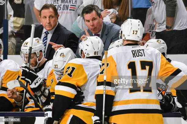 Head Coach Mike Sullivan of the Pittsburgh Penguins gives instructions to his team during a timeout against the Columbus Blue Jackets in Game Three...