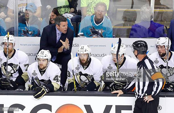 Head Coach Mike Sullivan of the Pittsburgh Penguins has a word for referee Dan O'Rourke during the first period of Game Three of the 2016 NHL Stanley...