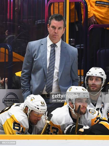 Head coach Mike Sullivan of the Pittsburgh Penguins watches his team play during the third period of Game Three of the 2017 NHL Stanley Cup Final at...