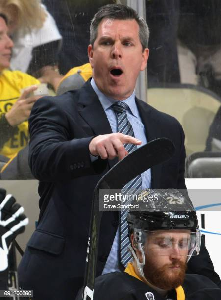 Head coach Mike Sullivan of the Pittsburgh Penguins yells at his team during the third period of Game Two of the 2017 NHL Stanley Cup Final against...