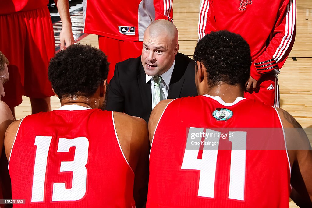 Head Coach Mike Taylor of the Maine Red Claws talks to his team during a time out in the NBA D-League game against the Idaho Stampede on December 26, 2012 at CenturyLink Arena in Boise, Idaho.