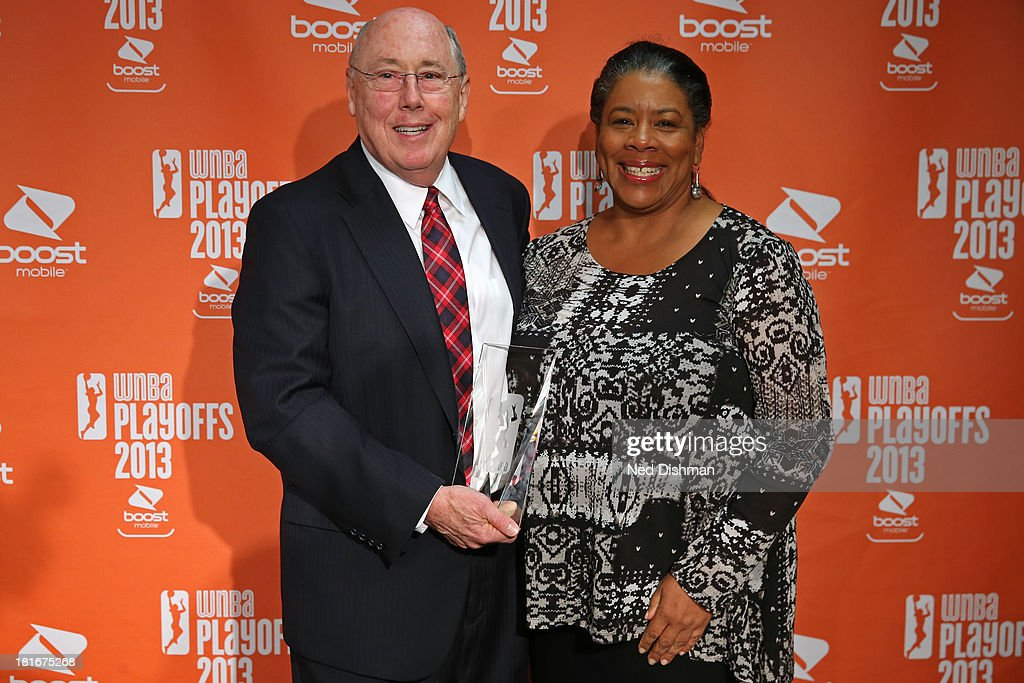 Head coach Mike Thibault of the Washington Mystics and the WNBA Commissioner Laurel J. Richie pose for a picture after he is awarded Coach of the Year at the Verizon Center on September 21, 2013 in Washington, DC.