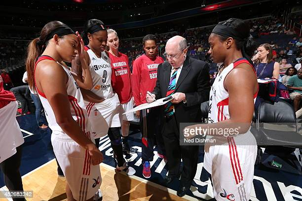 Head coach Mike Thibault of the Washington Mystics draws a play against the Tulsa Shock at the Verizon Center on July 25 2014 in Washington DC NOTE...