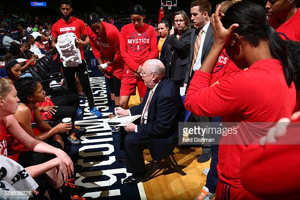Head coach Mike Thibault of the Washington Mystics huddles after a play against the San Antonio Stars on June 29 2016 at the Verizon Center in...