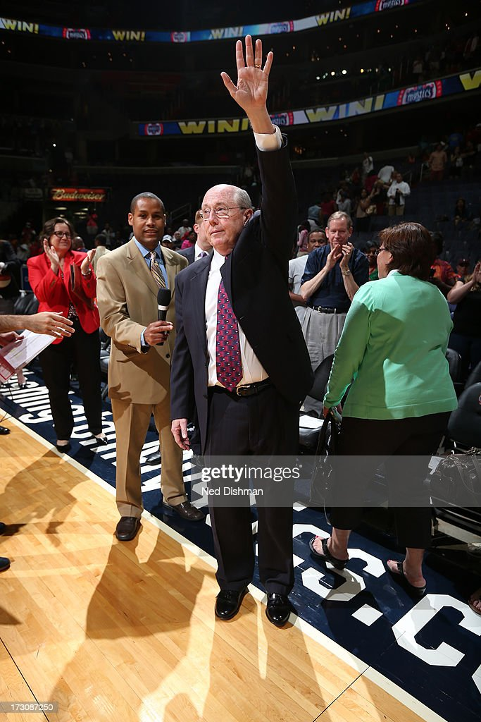 Head coach, <a gi-track='captionPersonalityLinkClicked' href=/galleries/search?phrase=Mike+Thibault&family=editorial&specificpeople=544624 ng-click='$event.stopPropagation()'>Mike Thibault</a>, of the Washington Mystics is recognized after becoming the all-time most winning coach in WNBA history against the Seattle Storm at the Verizon Center of July 6, 2012 in Washington, DC.