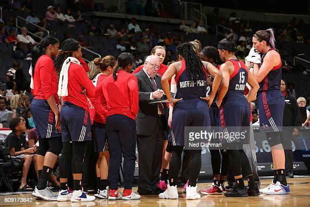 Head Coach Mike Thibault of the Washington Mystics talks with the team during the game against the Connecticut Sun on September 18 2016 at the...