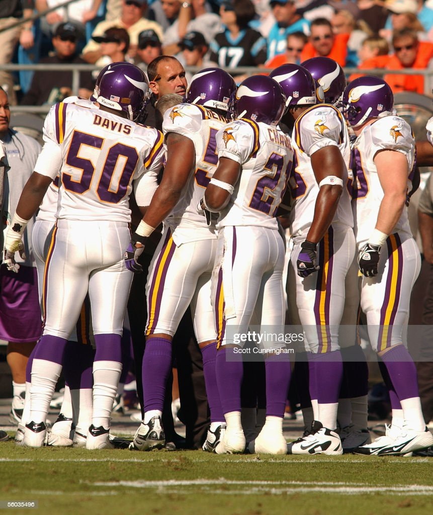 Head Coach Mike Tice of the Minnesota Vikings speaks with his team during a timeout against the Carolina Panthers on October 30, 2005 at Bank Of America Stadium in Charlotte, North Carolina. The Panthers defeated the Vikings 38-13.