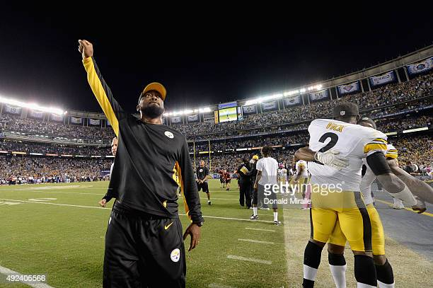 Head coach Mike Tomlin of the Pittsburgh Steelers and quarterback Mike Vick of the Pittsburgh Steelers celebrate after defeating the San Diego...