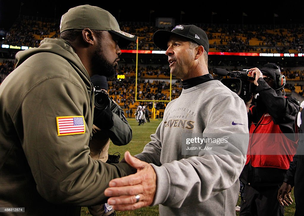 Head coach Mike Tomlin of the Pittsburgh Steelers is congratulated by head coach John Harbaugh of the Baltimore Ravens after Pittsburgh's 43-23 win at Heinz Field on November 2, 2014 in Pittsburgh, Pennsylvania.