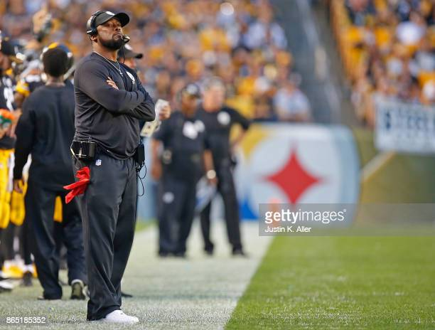 Head coach Mike Tomlin of the Pittsburgh Steelers looks on from the sidelines in the first half during the game against the Cincinnati Bengals at...